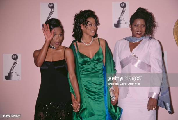 American actress Angela Bassett, American actress Lela Rochon, and American actress and singer Loretta Devine attend the 1996 NAACP Image Awards at...