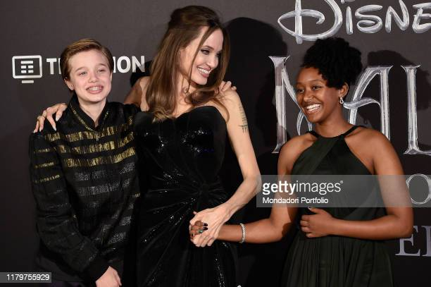 American actress Angelina Jolie and her children Shiloh Nouvel JoliePitt and Zahara Marley JoliePitt during the European premiere of the Disney film...