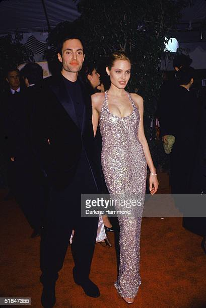 American actress Angelina Jolie with her brother American actor James Haven at the 56th Annual Golden Globe Awards where Jolie won the award for Best...