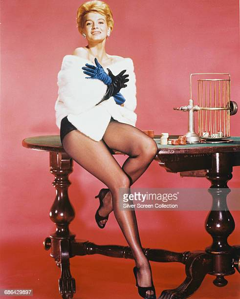 American actress Angie Dickinson poses on a roulette table circa 1960