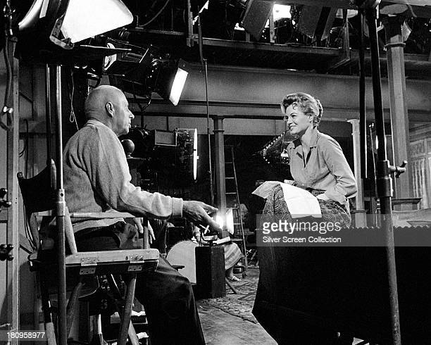 American actress Angie Dickinson talking to director Howard Hawks on the set of 'Rio Bravo' 1959