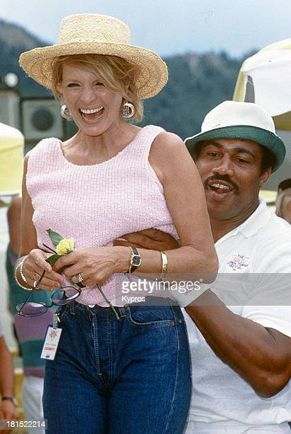 American actress Angie Dickinson with boxer Ken Norton at the Guess Open Tennis Festival Aspen Colorado circa 1984