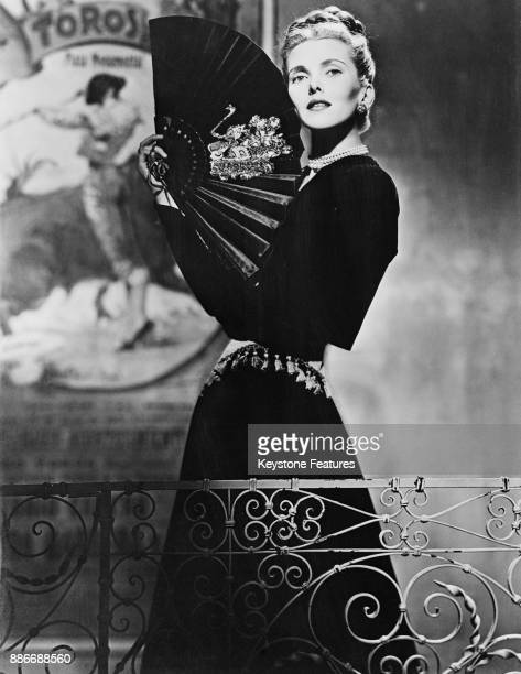American actress Anita Colby wearing a Spanishstyle ensemble in black velvet with a gold tasseled cummerbund May 1946