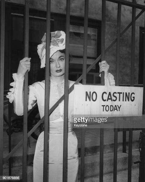 American actress Ann Blyth poses behind a sign reading 'No Casting Today' in Hollywood California circa 1955