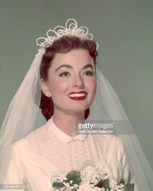 American actress Ann Blyth wearing a wedding dress and veil circa 1950