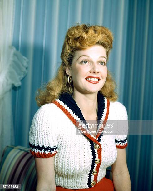 American actress Ann Sheridan in a red white and blue cardigan circa 1940