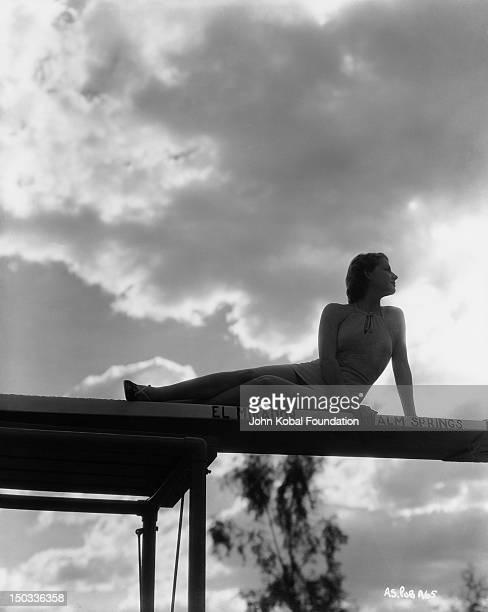 American actress Ann Sheridan on the diving board of El Mirador Hotel in Palm Springs California circa 1937