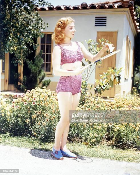 American actress Ann Sheridan playing badminton in a pink bikini circa 1948