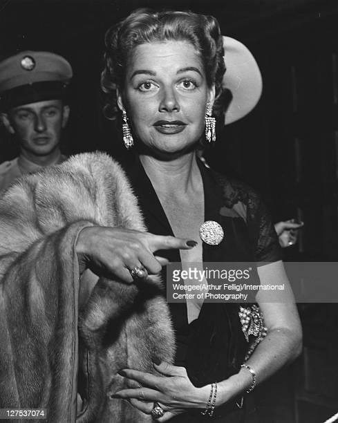 American actress Ann Sheridan points as she arrives at an unspecified event late 1940s or 1950s Photo by Weegee/International Center of...