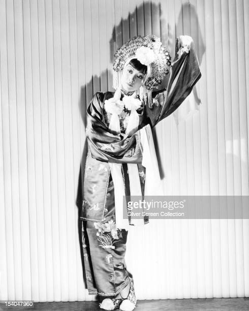 American actress Anna May Wong in a headdress and silk kimono circa 1935