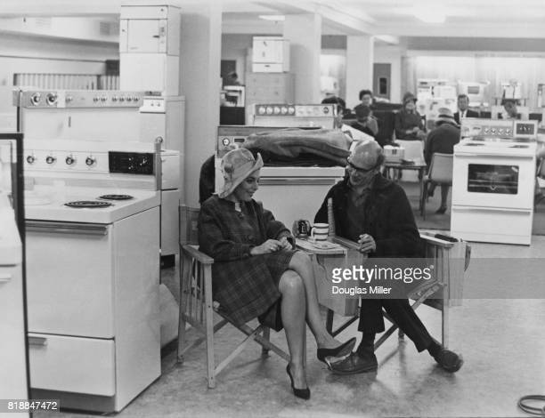 American actress Anne Bancroft with director Jack Clayton in the white goods department of Harrod's London to film a scene for 'The Pumpkin Eater'...