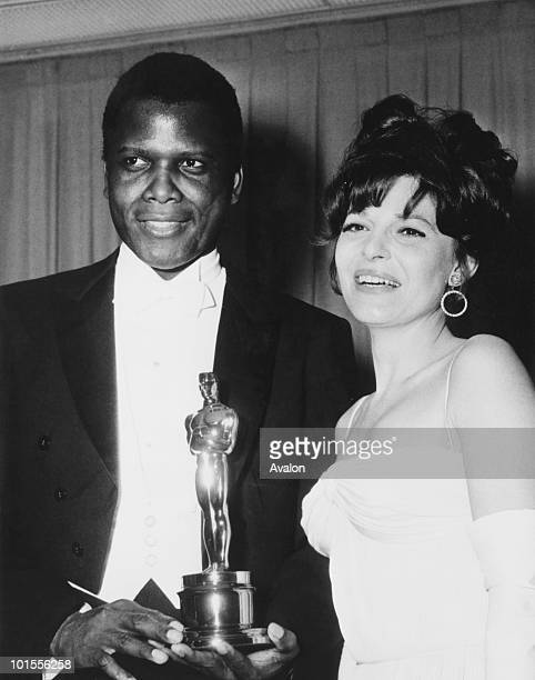 American actress Anne Bancroft with Sidney Poitier after she presented him with the Academy Award for Best Actor in a Leading Role at the Beverly...