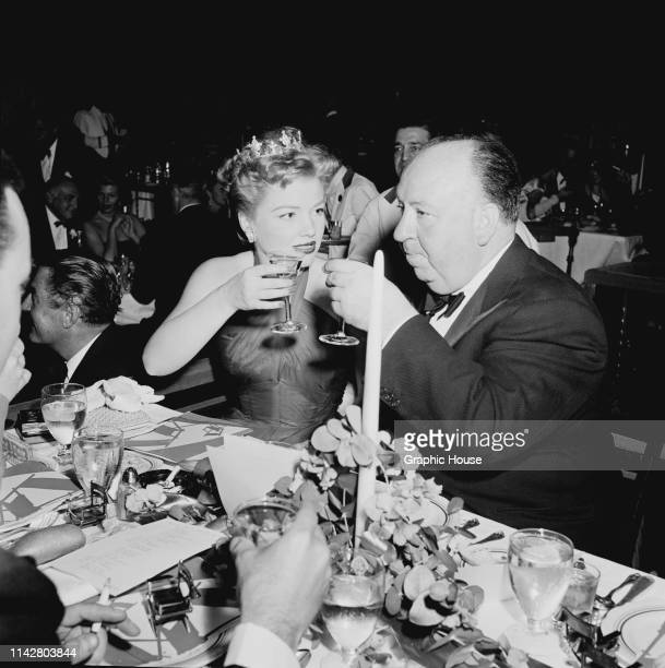 American actress Anne Baxter and English film director and producer Alfred Hitchcock at the Directors Guild of America Award US 1953