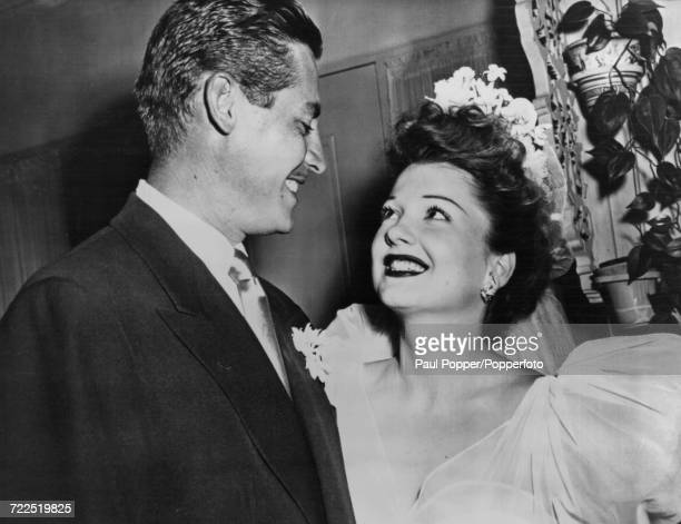 American actress Anne Baxter pictured with her husband American actor John Hodiak on their wedding day in Burlingame California on 7th July 1946