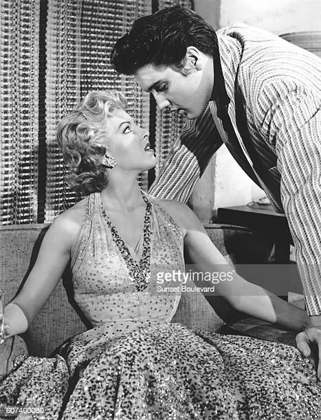 American actress Anne Neyland with singer and actor Elvis Presley on the set of Jailhouse Rock directed by Richard Thorpe