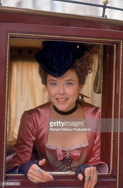 American actress Annette Bening looks out the window of a carriage on the Bordeaux set of the film Valmont directed by Czech director Milos Forman...