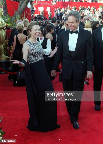 American actress Annette Bening poses for the press with her partner actor Warren Beatty as they arrive at the Dorothy Chandler Pavilion in Los...