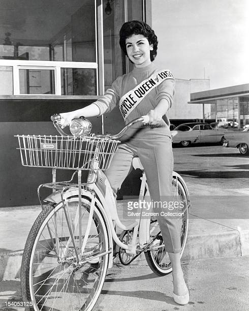 American actress Annette Funicello on a Schwinn Bicycle 1956 She is wearing a sash reading 'Bicycle Queen of 1953'
