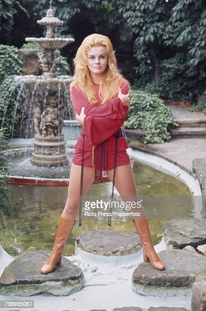 American actress AnnMargret posed wearing a red chemise hot pants outfit at Les Ambassadeurs Club in London on 31st August 1971 AnnMargret is...