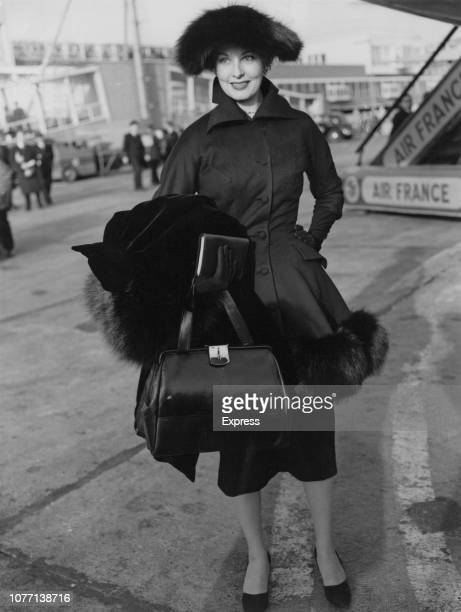 American actress Arlene Dahl arrives at London Airport to work on a new movie 24th November 1955