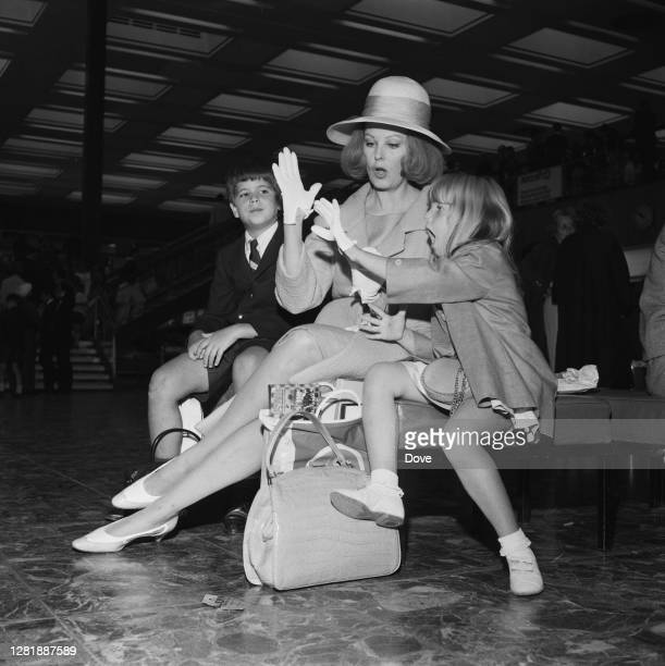 American actress Arlene Dahl with her children Lorenzo Lamas and Christina Holmes at London Airport UK 30th July 1966