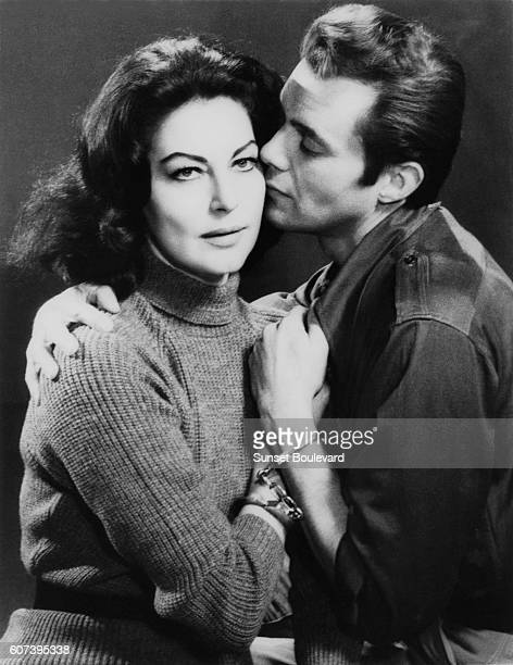 American actress Ava Gardner and British actor Dirk Bogarde on the set of The Angel Wore Red written and directed by Nunnally Johnson