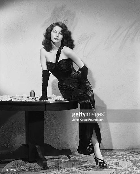 American actress Ava Gardner in black satin dress and gloves as femme fatale Kitty Collins in 'The Killers' directed by Robert Siodmak 1946
