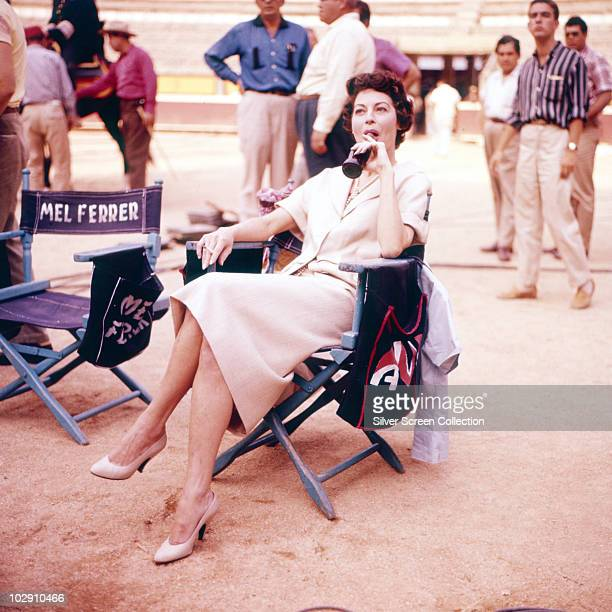 American actress Ava Gardner on the set of the film 'The Sun Also Rises' 1957 The chair next to her belongs to costar Mel Ferrer