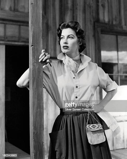 American actress Ava Gardner wearing a shirt with upturned collar and a belted pleated skirt circa 1950