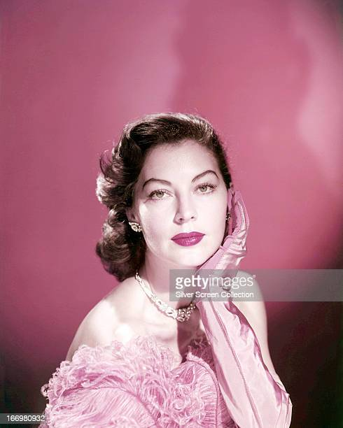 American actress Ava Gardner wearing pink evening gloves circa 1950