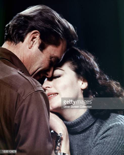 American actress Ava Gardner with English actor Dirk Bogarde in 'The Angel Wore Red' directed by Nunnally Johnson 1960
