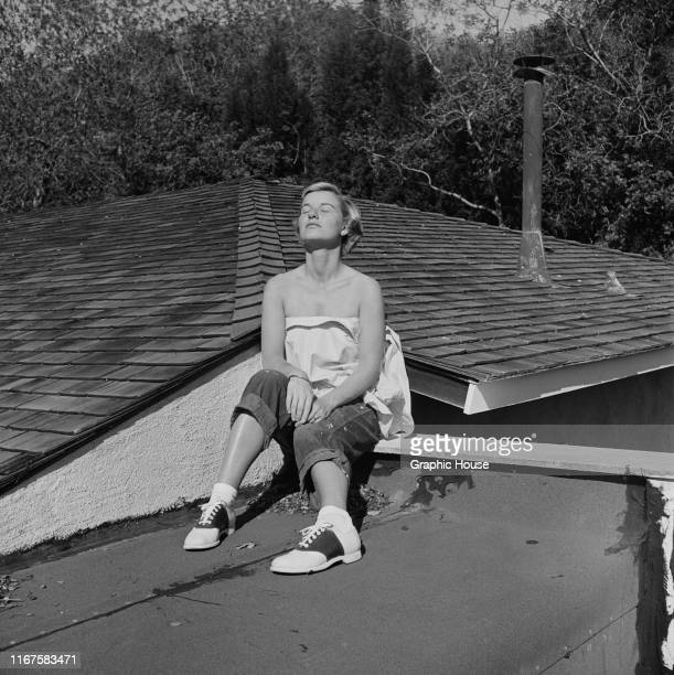 American actress Barbara Bel Geddes sunning herself on the roof of her new home in Brentwood, California, circa 1950. She is starring in the new 20th...