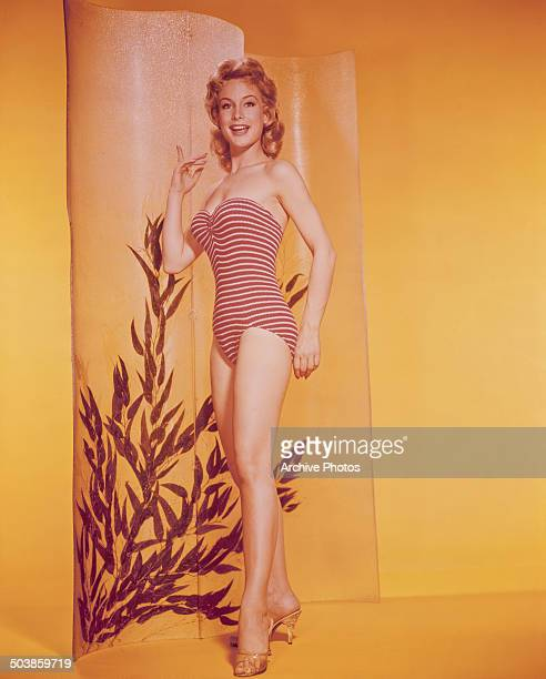 American actress Barbara Eden wearing a striped swimming costume circa 1959