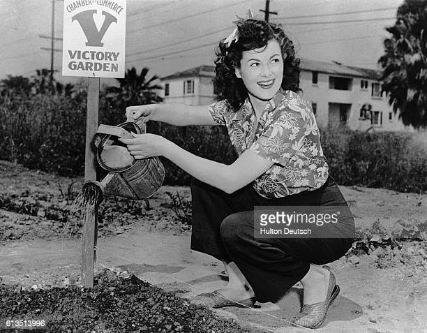 American actress Barbara Hale waters a communal garden established by the Chamber of Commerce United states 1945