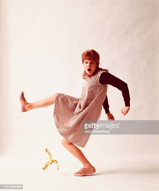 American actress Barbara Harris poses as though she were slipping on a banana peel against a white background New York New York June 22 1962