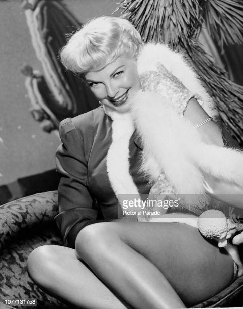 American actress Barbara Nichols dressed as a sexy Santa Claus at Christmas circa 1955