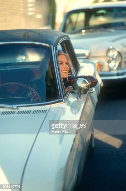 American actress Barbara Sigel drives her car through the gate on the Universal Studios lot circa November 1970 in Universal City California