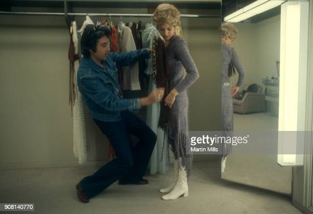 American actress Barbara Sigel looks at clothing in the dressing room on the Universal Studios lot circa November 1970 in Universal City California