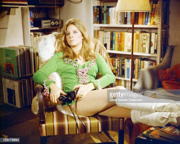 American actress Barbra Streisand, in a mini dress and white boots, as Doris in 'The Owl And The Pussycat', directed by Herbert Ross, 1970.