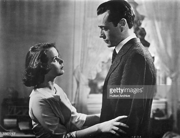 American actress Beatrice Pearson holds Mel Ferrer in a scene from the film 'Lost Boundaries'