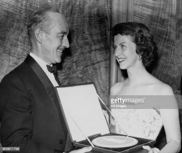 American actress Betsy Blair and British actor Alec Guinness at the presentation ceremony of the British Film Academy Awards at the Odeon Theatre...