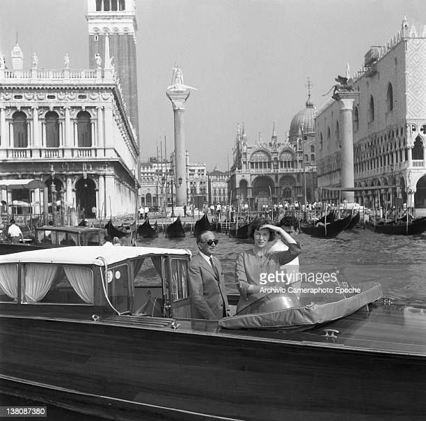 American actress Betsy Blair portrayed on a water taxi St Mark Square in the background Venice 1960