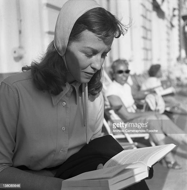 American actress Betsy Blair portrayed while reading a book Cannes 1955
