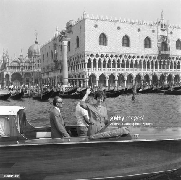 American actress Betsy Blair portrayed while waving from a water taxi St Mark Square in the background Venice 1960