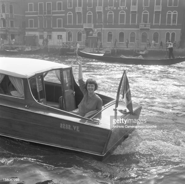 American actress Betsy Blair portrayed while waving from a water taxi crossing the Canal Grande Venice 1960