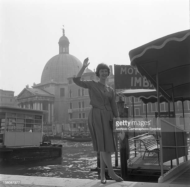 American actress Betsy Blair portrayed while waving outside the railway station Venice 1960
