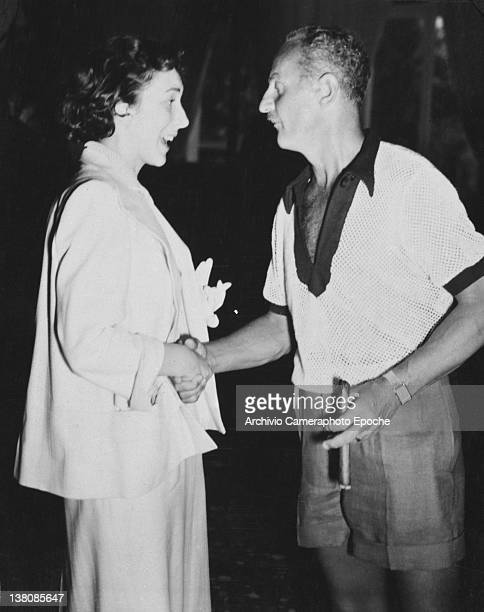 American actress Betsy Blair shaking hands to Darryl Francis Zanuck Venice Lido 1949