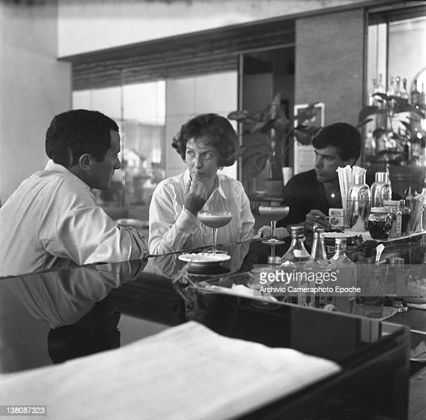 American actress Betsy Blair sitting at a bar counter portrayed while having a drink Lido Venice 1960