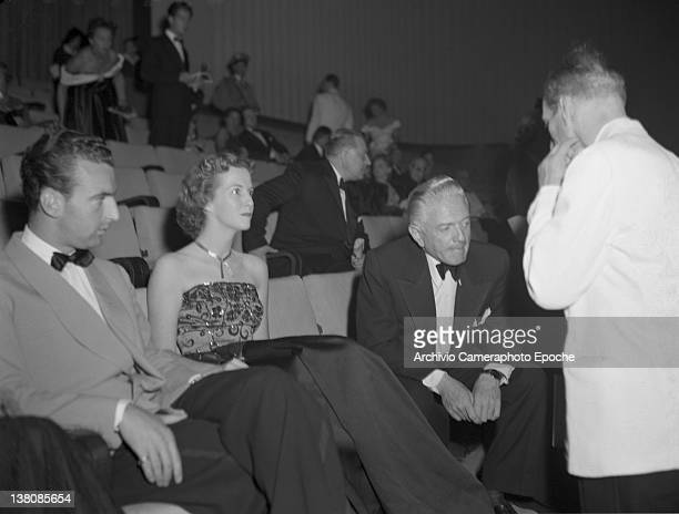 American actress Betsy Blair sitting with Luparini and Litvack in the front row during the Venice Movie Festival 1949 American Actress