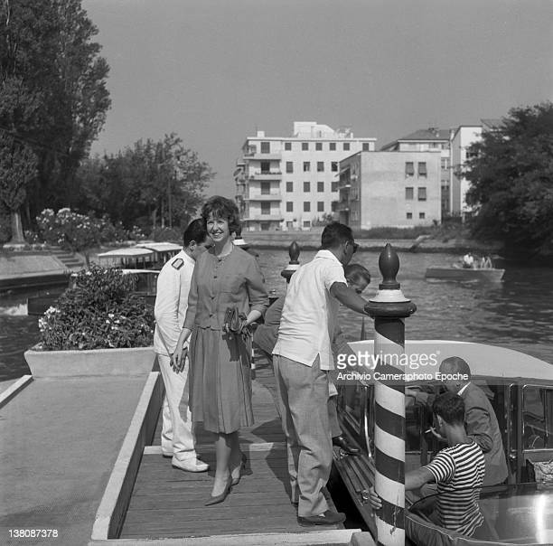 American actress Betsy Blair standing on a pier after getting down a water taxi Lido Venice 1960